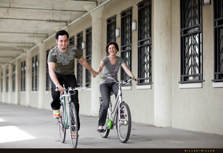 biking holding hands engagement couple