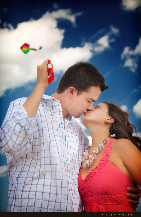 bold vibrant photos engagement kiss kite