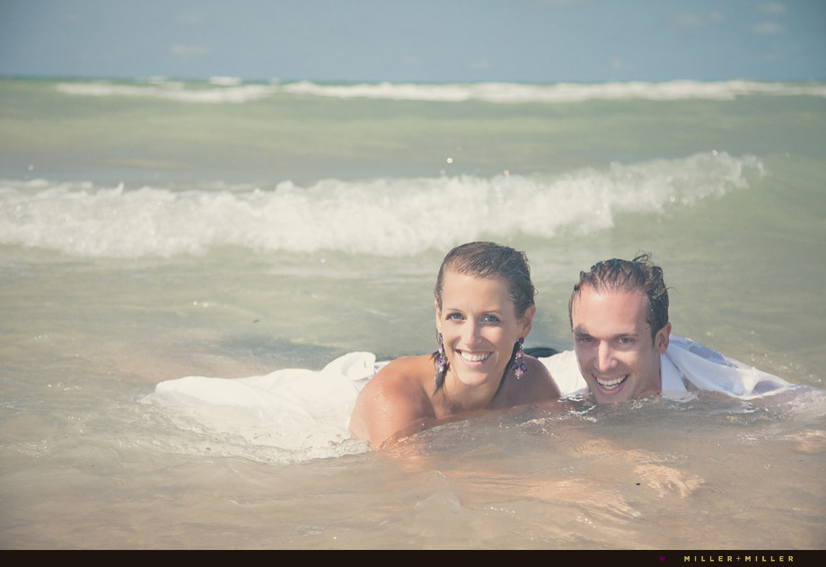 couple trash the dress in water