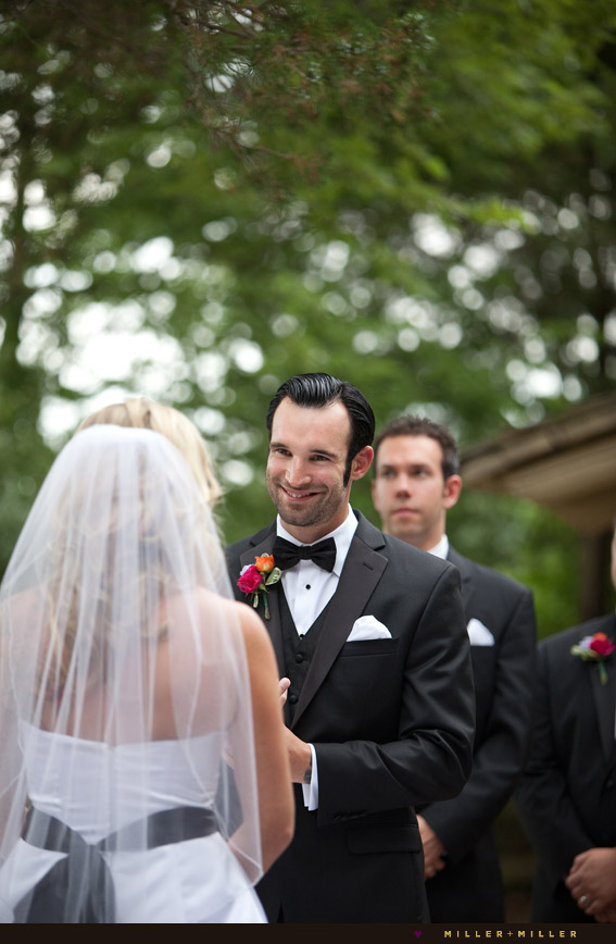 groom vows smiling