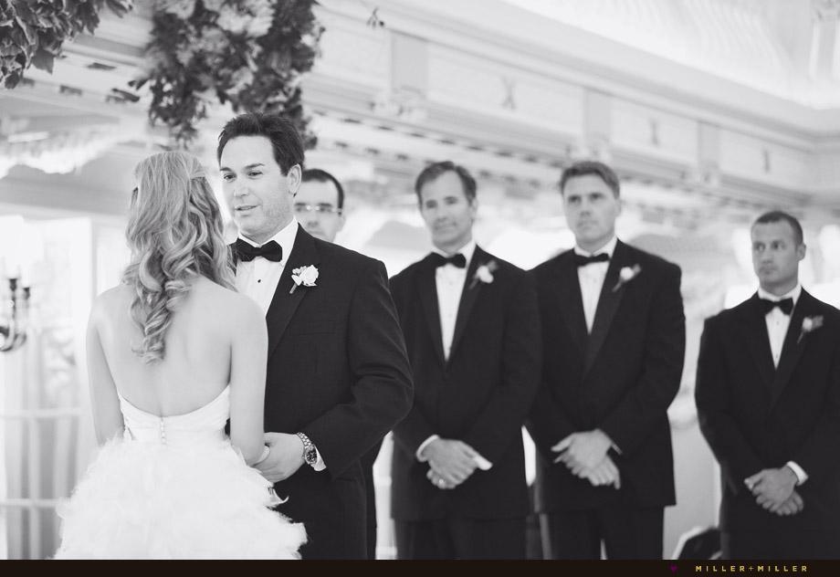 reciting vows groom groomsmen