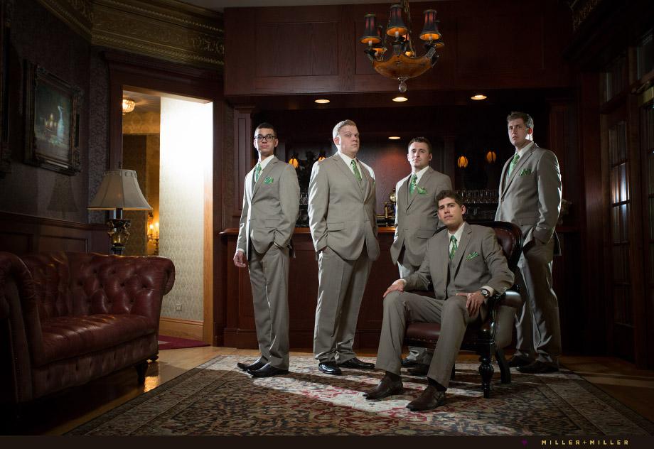 groomsmen groom sitting at bar photo