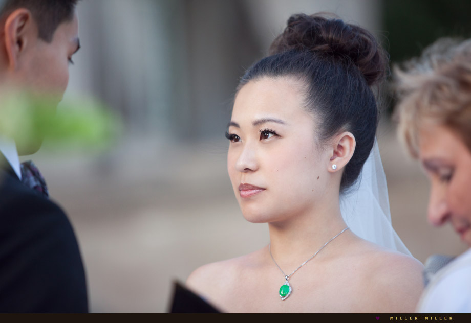 photographer photographs bride reciting vows