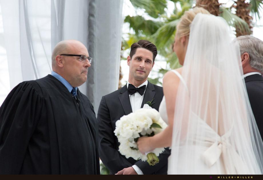 groom smiling at altar