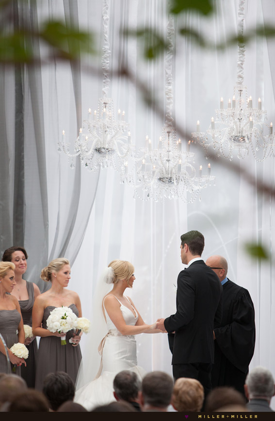vows under crystal chandeliers botanical garden