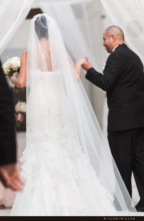 guiding bride up to alter