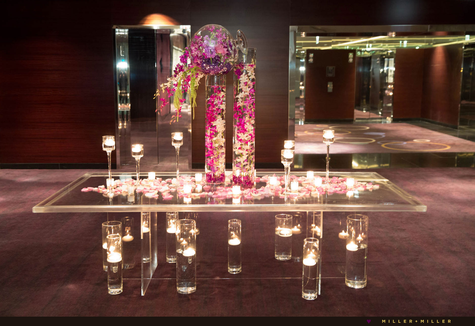 modern ghost glass table pink orchids purple