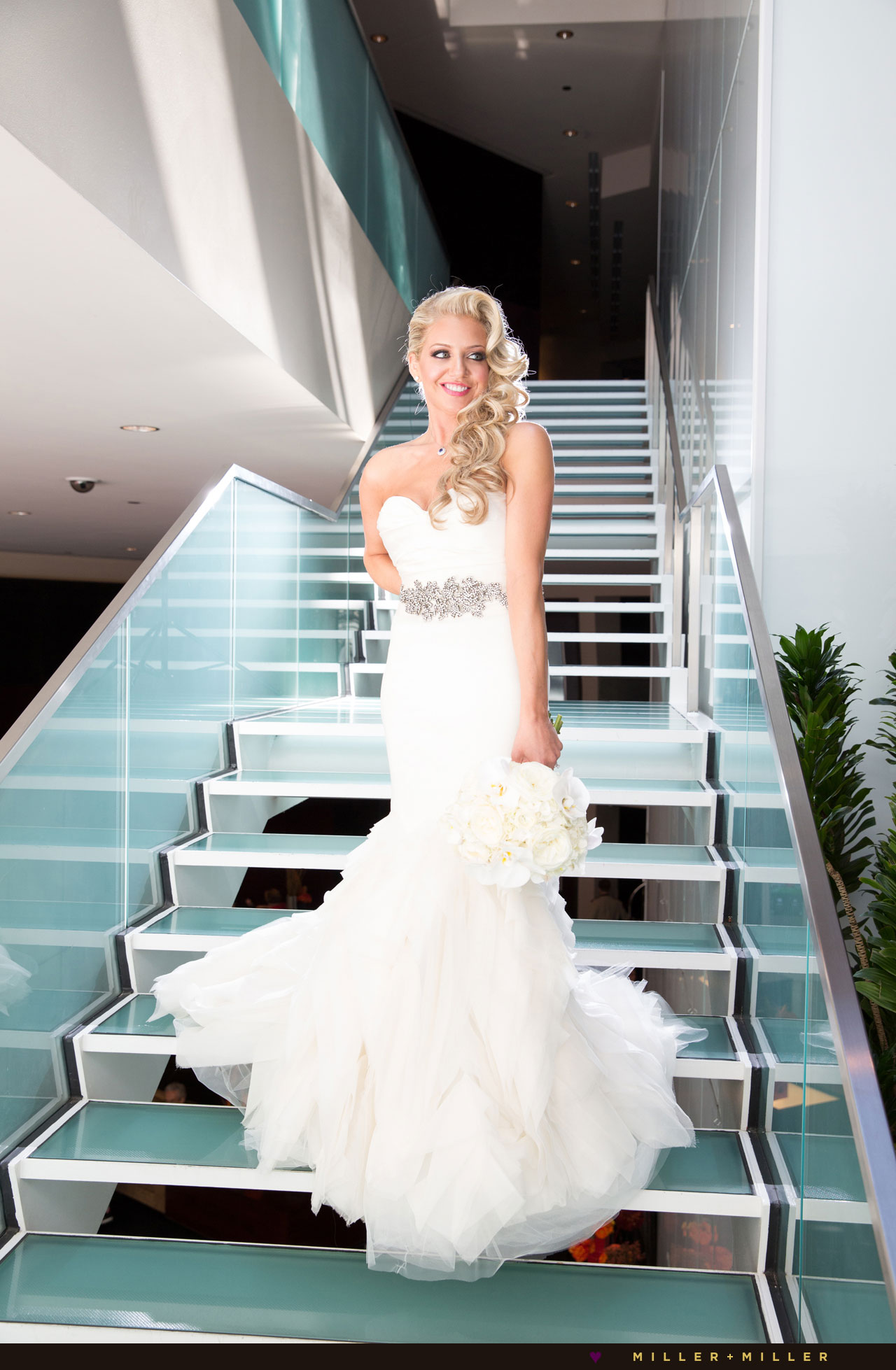 modern hotel glamorous bride glass staircase