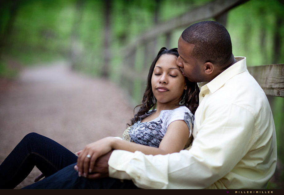 kiss cheek nature path romantic engagement