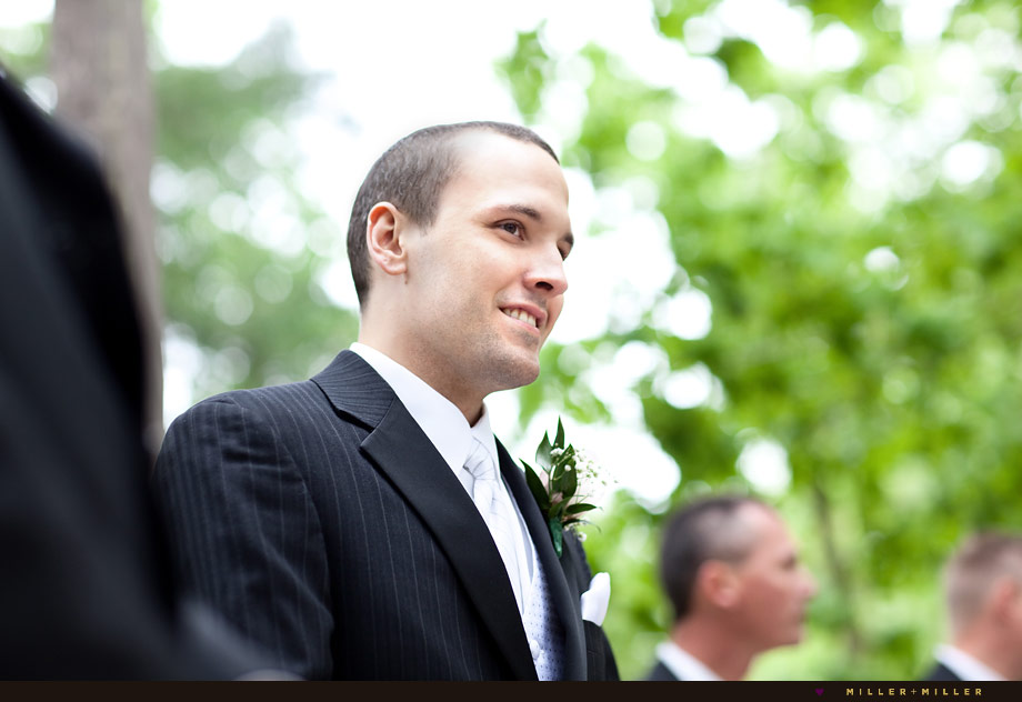 smiling groom outdoor wedding ceremony