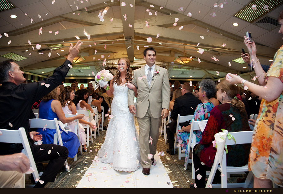 throwing petals Lake Lawn wedding ceremony aisle