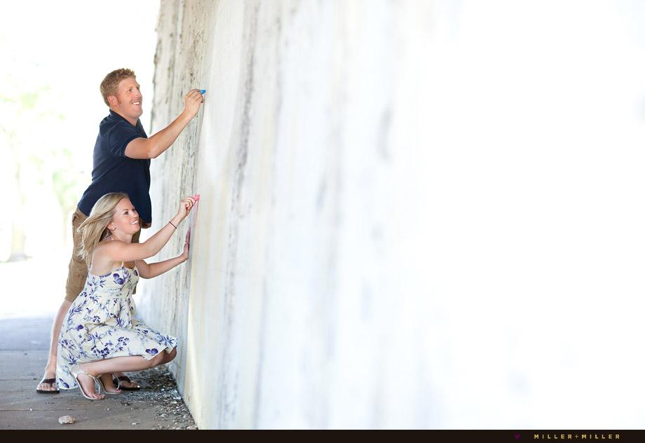 engaged couple chalk writing