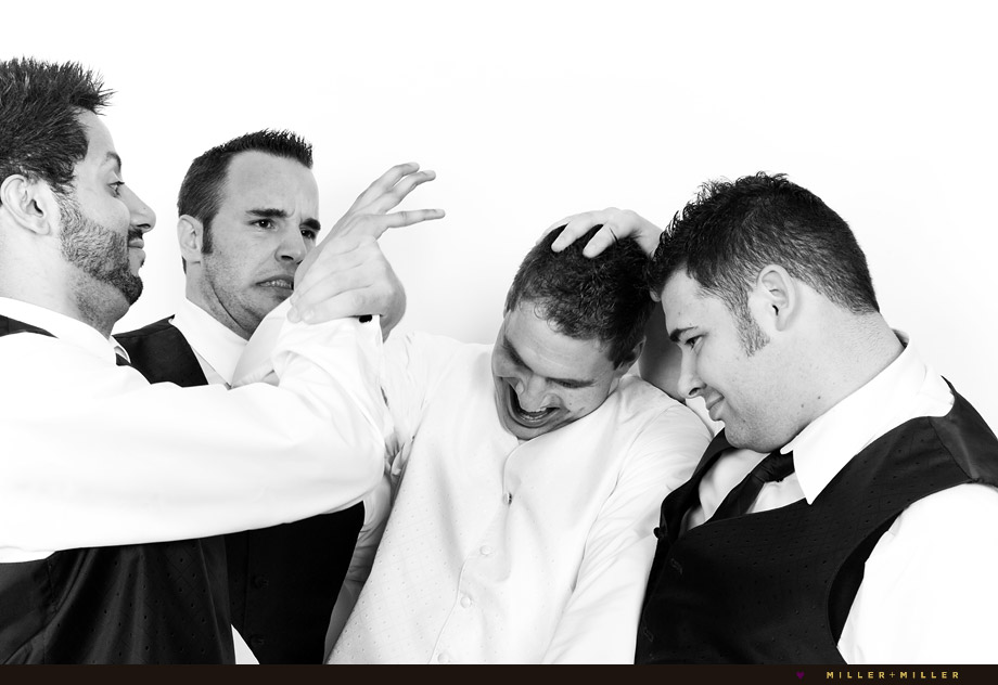 groomsmen attack groom black white picture