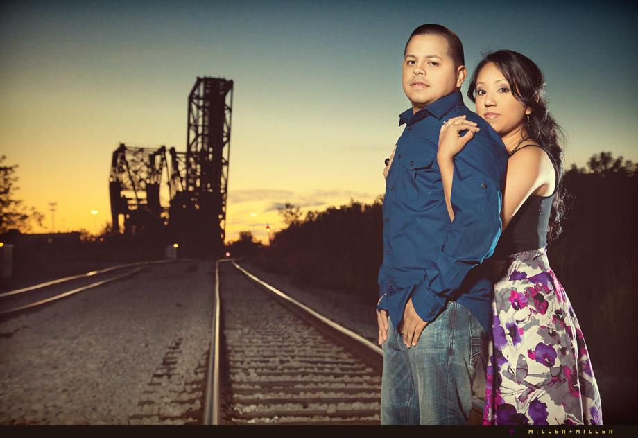 train tracks sunset engagement image