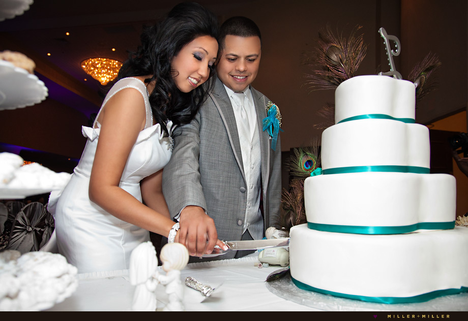 turquoise peacock wedding theme cake cutting