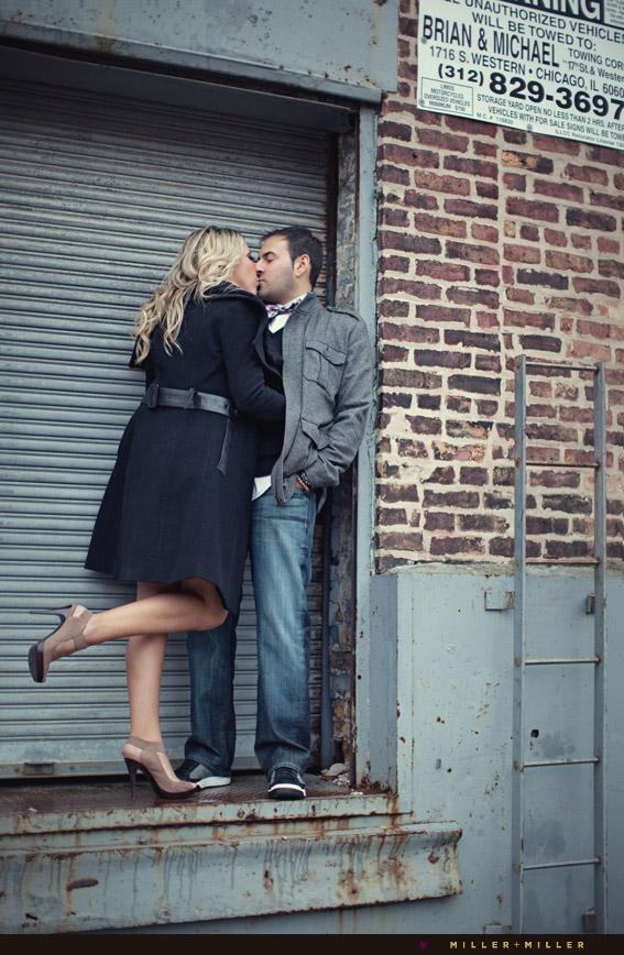 vintage kiss in warehouse alleyway