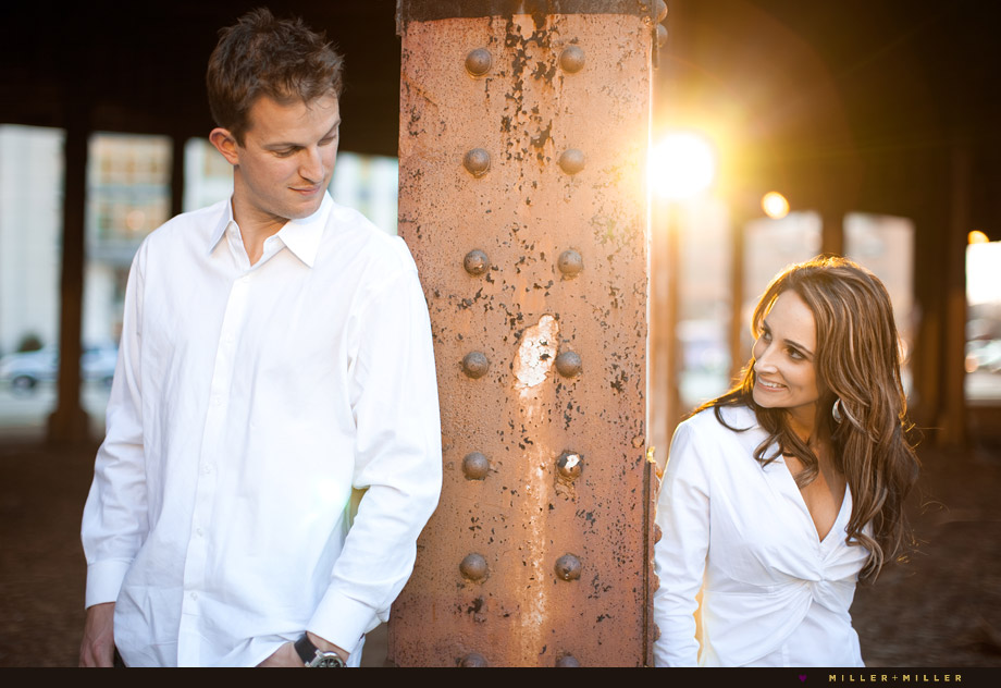 couple portraits by harbor at sunset