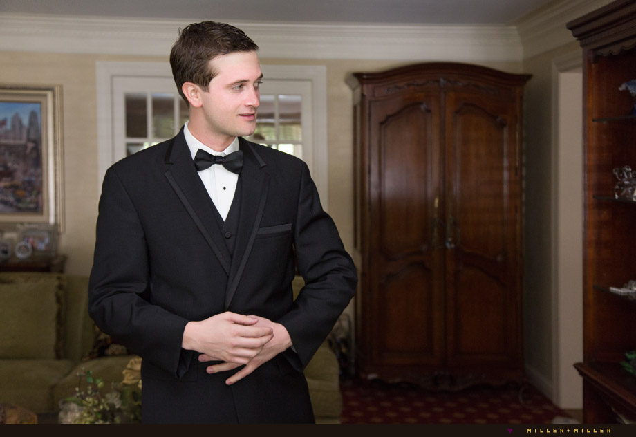 groom black suit bow tie
