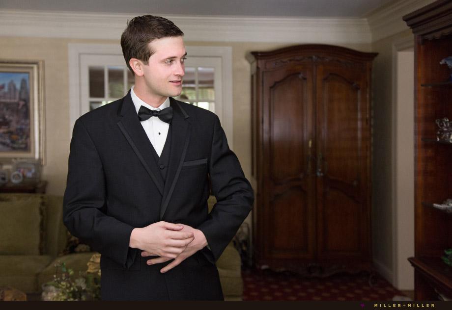 groom black suit bow tie