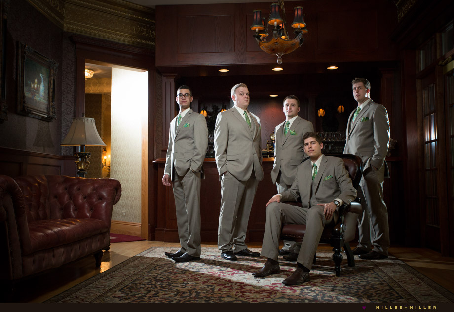 groomsmen groom sitting at bar photo