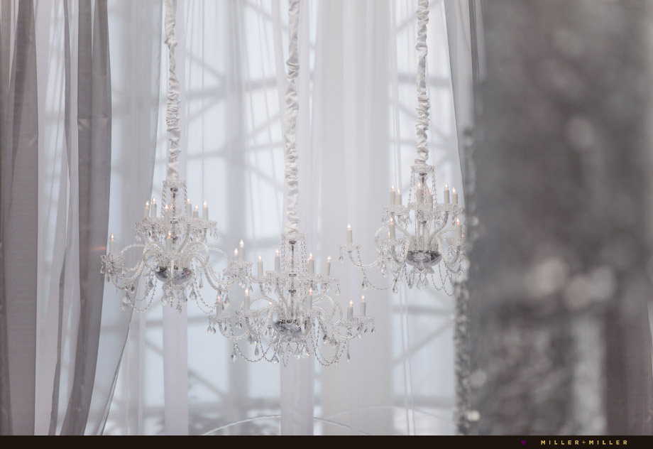 hanging crystal chandeliers above altar