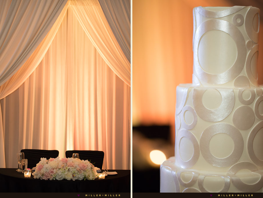 satin white hanging fabric over sweetheart table