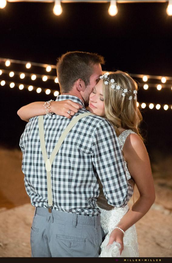 dancing under bulb string lights beach reception