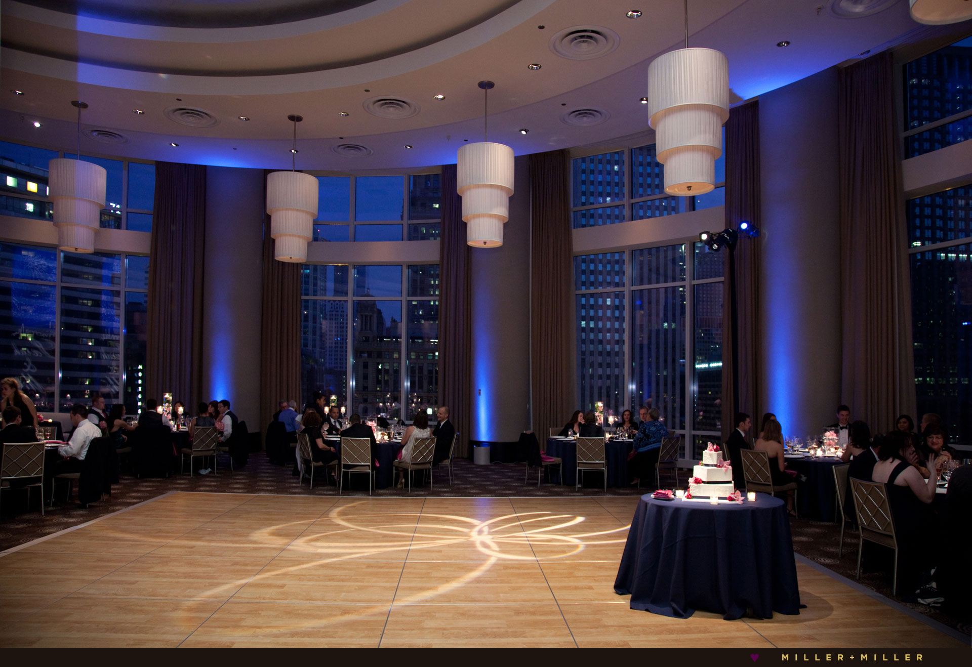 Trump ballroom blue Chicago night skyline